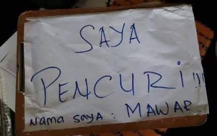 Ini tulisan yang memicu kemarahan warga terhadap pemilik ruko V-Gen di Kota Gunungsitoli. —Foto: Fajar Harefa via Facebook